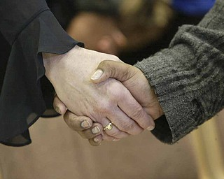YSU students and faculty joined hands during a Monday prayer service on campus for victims of a weekend shooting.