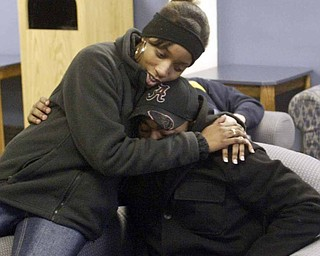 Tyler Thompson, one of the Youngstown State University students who was shot at a weekend party, gets a hug from fellow student Eve Griffins. Thompson wasn't listed among the original list of those injured because he says he didn't realize he'd been shot and sought medical attention on his own.