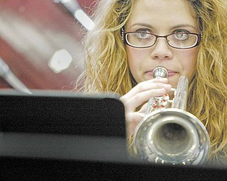 Boardman High School 12th grade band member Melanie D'eramo plays the trumpet during a practice. She is among 275 musicians in the Marching Band who have split up into other bands and ensembles for the winter season.