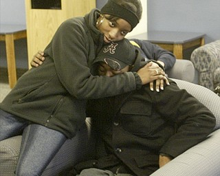 William D. Lewis the vindicator YSU shooting victim Tyler Thompson who was shot in the leg during an off campus party is hugged by YSU student Eve Griffins. Pixed on campus Monday 2-7-11