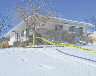 Investigators continued to work throughout the day Tuesday in this  house at 138 S. Cleveland Avenue in Niles to uncover evidence of  what caused the death of Lisa Fisher, 39. She was found dead on the   couch in the house on Monday afternoon, while her husband, John  Fisher, 53, was found badly injured from apparent self-inflicted  lacerations in a bedroom.
