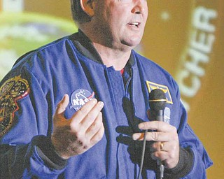 Astronaut Michael Foreman addresses 250 science teachers attending Trumbull County Educational Service Center's professional development program Tuesday  at Girard High School. Foreman shared insight into two space missions in which he logged more than 637 hours in space and five space walks. He also spoke to a group of Girard students.