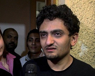 Egyptian Wael Ghonim, a Google Inc. marketing manager, talks at his home in Cairo, Egypt, Monday, Feb.7, 2011. A Google manager held in Egypt for about 10 days over anti-government protests was freed Monday.  (AP Photo/Ahmed Ali)