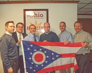 Receiving recognition: In honor of School Board Recognition Month, Columbiana County Recorder Craig Brown presented Salem City School Board members with an Ohio state flag. Pictured, from left, are Nick Bush, Brown, Steve Bailey, Brad Myers, Andrew Null and Jeff Cushman.