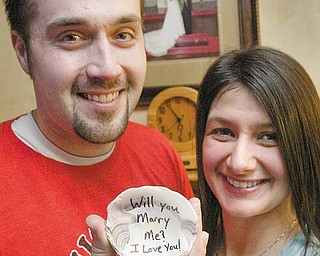 "Brian Brownlie proposed to his wife Melanie on a North Carolina beach in 2008 by leaving a shell in the sand that read, ""Will you marry me? I love you!"" The couple has been married since 2009."