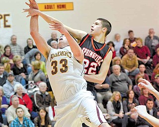 South Range junior Dan Good is fouled by Springfield junior Nick Russell.