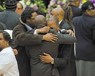 Mourners of the death of Jamail Johnson comfort one another at his funeral service held at YSU's Beeghly Center Saturday morning. Johnson, a YSU senior,  was killed in a shooting early February 6 at his residence north of the YSU campus. 11 people, including six YSU students, were wounded.