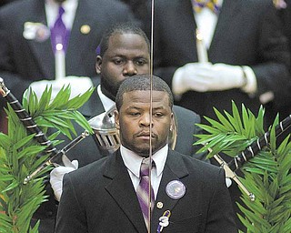 Members of the Omega Psi Phi fraternity gather during Jamail Johnson's calling hours Saturday morning at YSU's Beeghly Center.