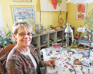 """Artist Donna Bostardi works on her handcrafted jewelry at 29 Logan Ave., """"A Little Gallery on the West Hill."""" The gallery, just west of downtown Sharon, is a mecca for handmade art deco, all made by the talented area artists."""