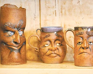 """""""Monday Morning Clay Mugs"""" by Jim Lutz of New Castle grace the shelf at 29 Logan Ave., """"A Little Gallery on the West Hill."""" The gallery, just west of downtown Sharon, is a mecca for handmade art deco, all made by the talented area artists."""