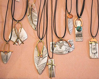"""Pewter, copper and bronze are cleverly made into necklaces and jewelry  by artist Donna Little of Sharon, an accomplished metal smith, at 29 Logan Ave., """"A Little Gallery on the West Hill."""" The gallery, just west of downtown Sharon, is a mecca for handmade art deco, all made by the talented area artists."""