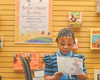 """A'Mya Moody, a second-grader from Paul C. Bunn Elementary, reads a selection called """"Books"""" during the African American Read-In held by the Youngstown City Schools at Barnes & Noble Booksellers in Boardman."""
