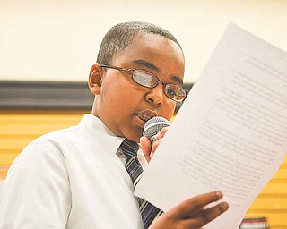 Ronson McDowell, a fourth grader from Paul C. Bunn Elementary, reads Barack Obama's back to school speech during the African American Read-In held by the Youngstown City Schools at Barnes & Noble Booksellers in Boardman.