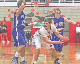 Struthers' Adam Ryczaj (40) looks for help as Colin Reardon (10) and Anthony Machi (2) play defense during their game Wednesday night.