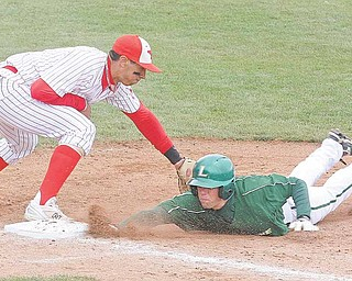 Brett Botsford beats the tag of YSU's Jeremy Banks during their game Sunday afternoon.