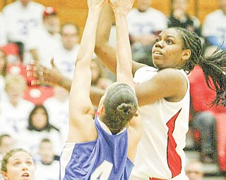 YSU sophomore forward Brandi Brown, right, leads the Horizon League in scoring at 18.6 points per game. She's scored 20 or more points 12 times, including eight times in league play.