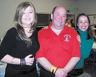 Tom Lamb, of Boardman, center, traveled to California for a fundraiser to benefit Lea Allen, 28, left. Lamb, Allen and Kana Yang, right, all have epithelioid sarcoma and met one another through an online support group.