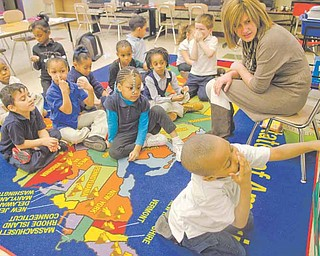 Above, Josiah Young, 5, participates in an exercise matching words and images with their beginning letter in Kim Marzano's kindergarten class at Taft Elementary School in Youngstown. Teachers at the school use DonorsChoose.org to garner donations to buy teaching materials for their classrooms.