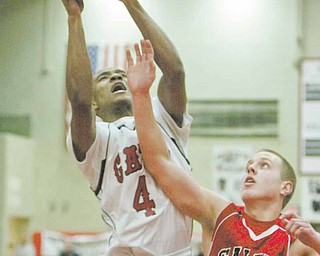 Will Clark of Struthers, left, shoots around Salem's Taylor Fredrickson during Tuesday's game at Struthers.