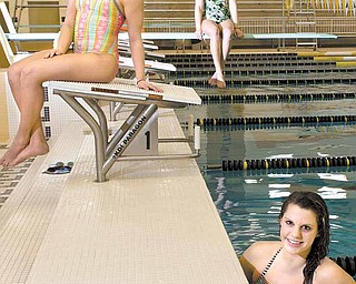From left, Lakeview's Emilee Gysegem, McDonald's Katie Joseph and Maplewood's Jordan Moxley take a break during practice Wednesday at the Warren Harding High School pool. Since they go to schools that do not boast big swim teams, the girls train together as teammates under coach Frank Supancic. This weekend's district meet in Cleveland will be one of the last times in their high school careers that they will swim together in competition.