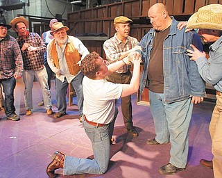 he cast of the Youngstown Playhouse's production of 'Of Mice and Men,' acts out a scene during a recent rehearsal. The production runs February 18th through the 27th.