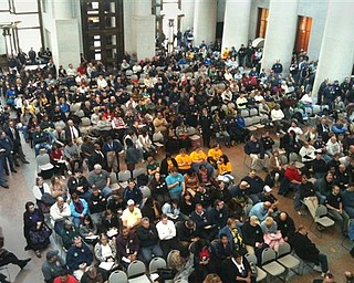 Hundreds of unionized firefighters, police officers, teachers and others overflowed a hearing room Tuesday, Feb. 15, 2011, at the Statehouse in Columbus, Ohio, where supporters testified on a proposal to end collective bargaining in Ohio. (AP Photo/The Dayton Daily News, Laura Bischoff)