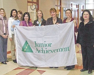 Proving that they support Junior Achievement and its Done-in-a-Day teaching project are, from left, Michele Merkel, Leah Wilson, Marion Dunham, Nicole Laura Rumble, Nicole Widomski, Kim Urig, Anna Sexton Aey, members of the Junior League of Youngstown; and Patty Scalzo, guidance counselor at Taft Elementary School.