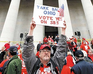 Richard Ringo, a members of The Ohio Liberty Council, a coalition of over 60 tea party groups and liberty minded organizations across Ohio, holds a sign in support of Senate Bill 5, at the Ohio Statehouse Thursday, Feb 17, 2011, in Columbus, Ohio. (AP Photo/Terry Gilliam)