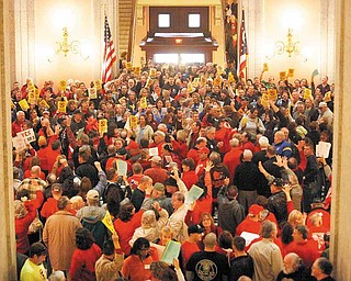 Hundreds of supporters for and against Senate Bill 5, fill the Ohio Statehouse rotunda Thursday, Feb 17, 2011, in Columbus, Ohio. (AP Photo/Terry Gilliam)