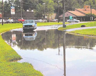 This photo, supplied by the Learning Express Preschool Center on Coit Street Northwest, Warren, shows the flooding problem that occurs just west of the day-care center during warm weather.