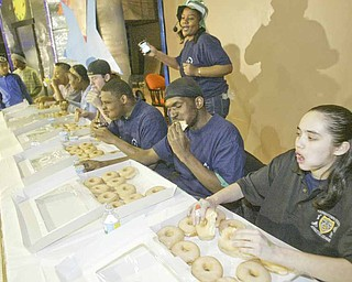 Young people crammed down doughnuts to see who could in the most of the sugary treats in the shortest amount of time. The doughnut-eating contest was one of the events at the fourth annual Criminal Justice Fair Saturday at Heartreach Ministries in Youngstown.