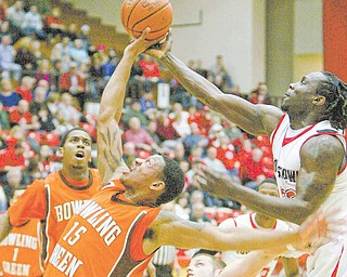 YSU's Ashen Ward, RIGHT and BGSU's A'uston Calhoun go for a rebound during first half action Saturday.