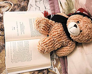 A stuffed animal and an open religious book at Hannah's House in Vienna  Township.