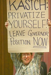 Lynn Anderson, a laid off state worker of Youngstown, lets her feelings be known during the rally.