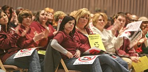 Members of the Boardman school teachers union cheer during a rally against Senate Bill 5 at Youngstown State University. The public forum drew more than 1,200 people Monday afternoon to protest the bill that would end collective bargaining for state employees.