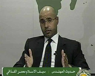 In this video image broadcast on Libyan state television early Monday Feb. 21, 2011 Seif al-Islam, son of longtime Libyan leader Moammar Gadhafi, speaks. Al-Islam says protesters have seized control of some military bases and tanks, and also warned of civil war in the country that would burn its oil wealth.