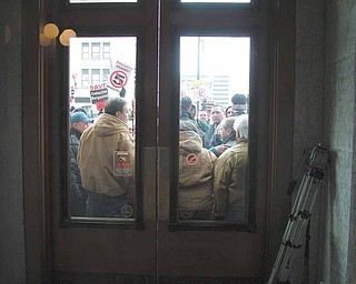 Demonstrators against Senate Bill 5 were locked out of the Statehouse on Tuesday.