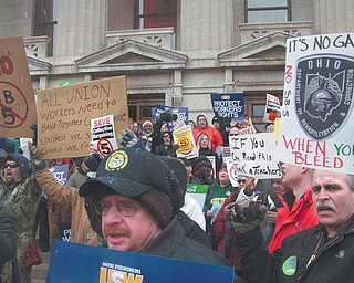 Groups of protesters gathered Tuesday outside the statehouse in Columbus to voice their opposition for Senate Bill 5, which would eliminate collective bargaining for state workers in Ohio, Only about 1,500 people were allowed inside the building, which left more than 3,000 people standing out in the cold.