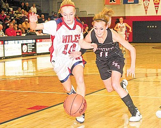 Struthers' Katelyn Ardale battles Samii Ramer (10) for the ball during their game Wednesday night in Austintown.