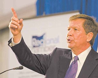 Gov. John Kasich speaks to a crowd of 480 at a Youngstown/Warren Regional Chamber luncheon in a hangar at the Youngstown-Warren Regional Airport in Vienna. He discussed Senate Bill 5, which would limit collective bargaining in Ohio, and his jobs initiative for the state.