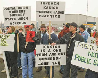 Kasich didn't receive a warm reception from about 700 union members and their supporters who came to criticize his decision to support legislation that would end or limit collective bargaining for state employees.
