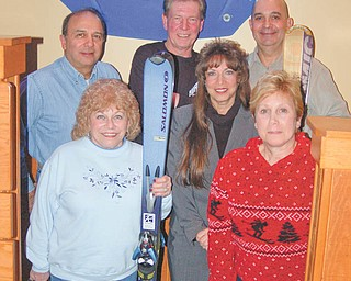 Skis the limit: The Warren Ski Club will present a beerfest and auction from 6:30 to 9:30 p.m. March 11 at McMenamy's Restaurant, 325 Youngstown-Warren Road, Niles. Admission to the auction is free. Beer-tasting samples will be available for $10 from five Ohio microbrewers: Great Lakes, Rust Belt, Ohio, Thirsty Dog and Willoughby Brewers. There also will be a cash bar. Part of the proceeds will benefit Three Trackers of Ohio, an all-volunteer group that promotes adaptive recreational sports for those with physical disabilities. For more information visit www.warrenskiclub.org. Some members of the auction committee are, in front, from left, Nancy Iezzi Dom, Mary Kirila and Gigi Ferris, and, in back, Bob Shimek, club president; Jack Kumik; and Joe Nardella.