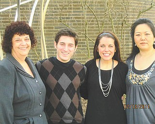 From left to right are Carla Infante, president of the Youngstown Opera Guild; Neil Meloro and Kayla Wilson, vocal students at Youngstown State University; and Dr. Misook Yun, vocal professor at YSU. The guild's scholarship luncheon will be March 5.