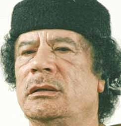 "Libya's Moammar Gadhafi talks during a debate on the sidelines of celebrations marking the 30-year anniversary of the declaration of the ""jamahiriya,"" or ""rule of the masses, in Sabha, Libya Friday, March 2, 2007. Gadhafi said in an unusual debate Friday it was time for his long-isolated nation to open up to the world and that one day it won't need him as leader. Still, he touted the ruling ideology he has entrenched here for three decades as superior to Western democracy."