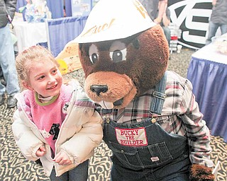 Megan Miller, 5, of Salem gets a hug from Bucky the Builder, the beaver mascot of the Home Builders-Remodelers Association of the Mahoning Valley. Jake Amon of Poland portrayed Bucky at the 60th annual HBA Home and Garden Show, which continues from 10 a.m. to 6 p.m. today at Mr. Anthony's Banquet Center in Boardman.