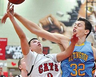 Struthers' Jake Jacubec (3) is fouled by Stephan Jankovic (32) of Huntington Prep.