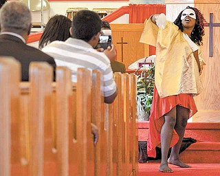 Lela Decembly, 26, performs an inspirational dance during a talent show held Sunday afternoon at Beulah Baptist Church in Youngstown.