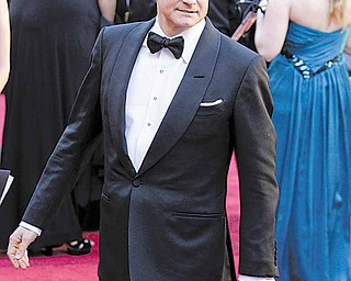 Actor Colin Firth arrives before the 83rd Academy Awards on Sunday, Feb. 27, 2011, in the Hollywood section of Los Angeles.