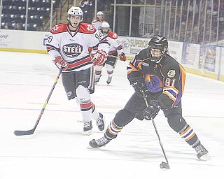 Phantoms Dylan Margonari (91) looks to pass as Tim Weber (14) plays defense during thieir game Sunday afternoon in Youngstown.