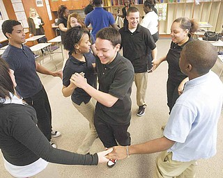 East High School students practice dancing in preparation for Friday's Quinceanera. In the center of the circle are juniors Miguel Cintron and Michelle Lozada.